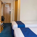Twin beds in room 246, one is against bathroom wall, to the left is door to adjacent room