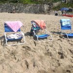 The little chairs and towels lent to us by the Hotel. This is on the beach opposite the hotel.