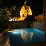 San Pedro Claver reflected in pool at night.  you can use the pool all night, just be respectful