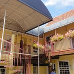Motel style balcony rooms with circular staircase