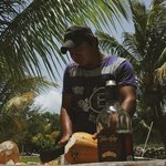 Freddy, chopping up some coconuts for our rum