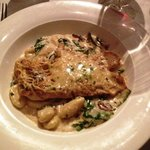 grilled marinated chicken breast with roasted mushroom & spinach in a arlic truffle cream sauce