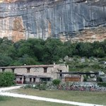 restaurant with limestone cliff backdrop