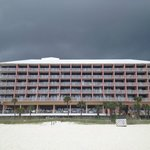 beach view of motel before storm