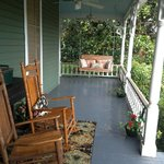 Lovely Front Porch~the perfect place for a glass of wine in the evening. :)