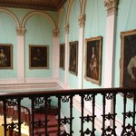 The stairwell at Temple House is lined with original oil paintings