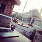 Working from the rooftop with a view of the Blue Mosque