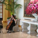 Morning duo playing classical music in lobby and beautiful flowers throughout