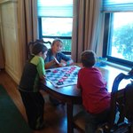 Kids enjoying a game we brought in the dining area.