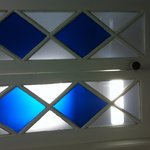 Beautiful blue glass panes leading to the bathroom