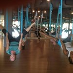 Here I am on the left upside down trying Skyfly Yoga with ABF Team!