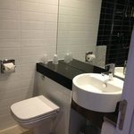 Lovely new looking toilet and wash basin area