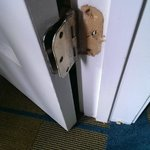 Broken hinge on closet door... typical of the room condition