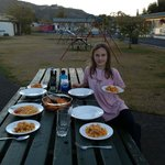 Eating dinner at a picnic table on the grounds of the motel
