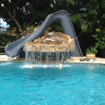 pool with water slide and waterfall