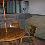 outdoor patio grill and umbrella chairs