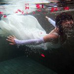 The wife swam in a wedding dress