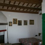 "room ""La Contrada"" with the original fireplace"