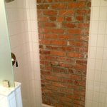 Beautiful exposed brickwork in the shower