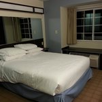 Queen Suite. Triple sheeted bed! Thumbs up! Didn't have all the lights on. Comfortable bed and p
