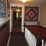 Upstairs hallway and some of Theresa's quilt wall hangings.