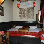 Our kang bed with tea table and abacus