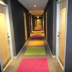 Very colorful carpet in hallway
