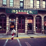 In front of the Bullock Hotel on Main Street
