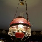 Cranberry glass chandelier in dining room