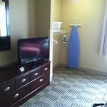Flat screen TV and laundry area