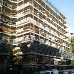 The exterior of the hotel with scaffolding