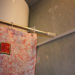 Shower curtain just resting on electrical conduit