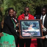 First Lady Margaret Kenyatta (right) receives photo gift from Friends of Karura Forest, June 201