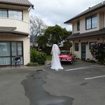 Bride approaching at Arrow Motel