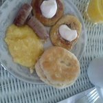 Breakfast: grits, homemade biscuits, local sausage, blueberry pancakes, OJ, and coffee