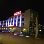 Night view of the front of Hotel Keflavik
