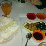 cheese, olives and fresh juice for breakfast
