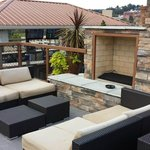 The upper level of the rooftop deck has a nice conversation area with fireplace.