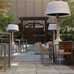 Courtyard and lounge features oversized lampshade heaters that provide heat and light