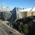 Room view of the natural history museum, the ROM, with its crystal facade overhanging Bloor St.