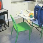 Green plastic chairs - We paid to stay in a room with leather chairs & higher quality furnishing