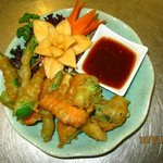 Deep fried selection of vegetable in batter served with sweet chilli sauce.
