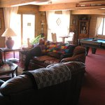 large sitting area with billiards table & t.v.