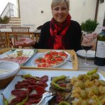 Enjoying an antipasto and some wonderful Rignana wine!