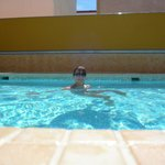 on my own in the pool but good job its tiny