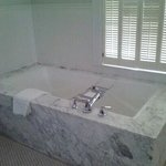 Huge marble tub with lavender bath salts...relaxing