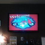 Our welcome on the TV on the wall in the front office