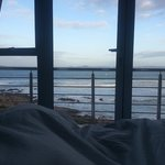 Lying in bed and looking at the sea at Crystal Lagoon Lodge