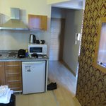 Kitchenette from sitting area in apartment