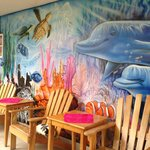 Beautiful mural in front with chairs to relax in